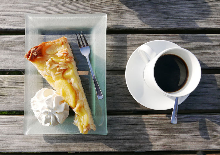 Apple cake with coffee in the afternoon Afternoon Cake Apfelkuchen  Apple Cake Cake Cake,dessert,apple Cake, Coffee Day Dessert Desserts Food Food And Drink Freshness German Food Kuchen No People Outdoors Sunny Table Wood - Material