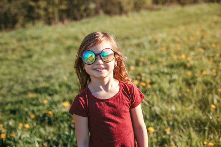 Portrait of smiling girl wearing sunglasses