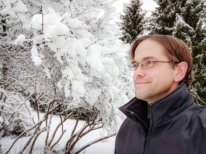 Man Smiling, Enjoying the Winter Weather Outdoors Winter Snow ❄ Cold Cold Days Nature Young Man Male person Enjoying Life Happy Smiling Natural Beauty White Color Copy Space Portrait Eyeglasses  Headshot Close-up Head And Shoulders Glasses Snow Covered Caucasian Thoughtful