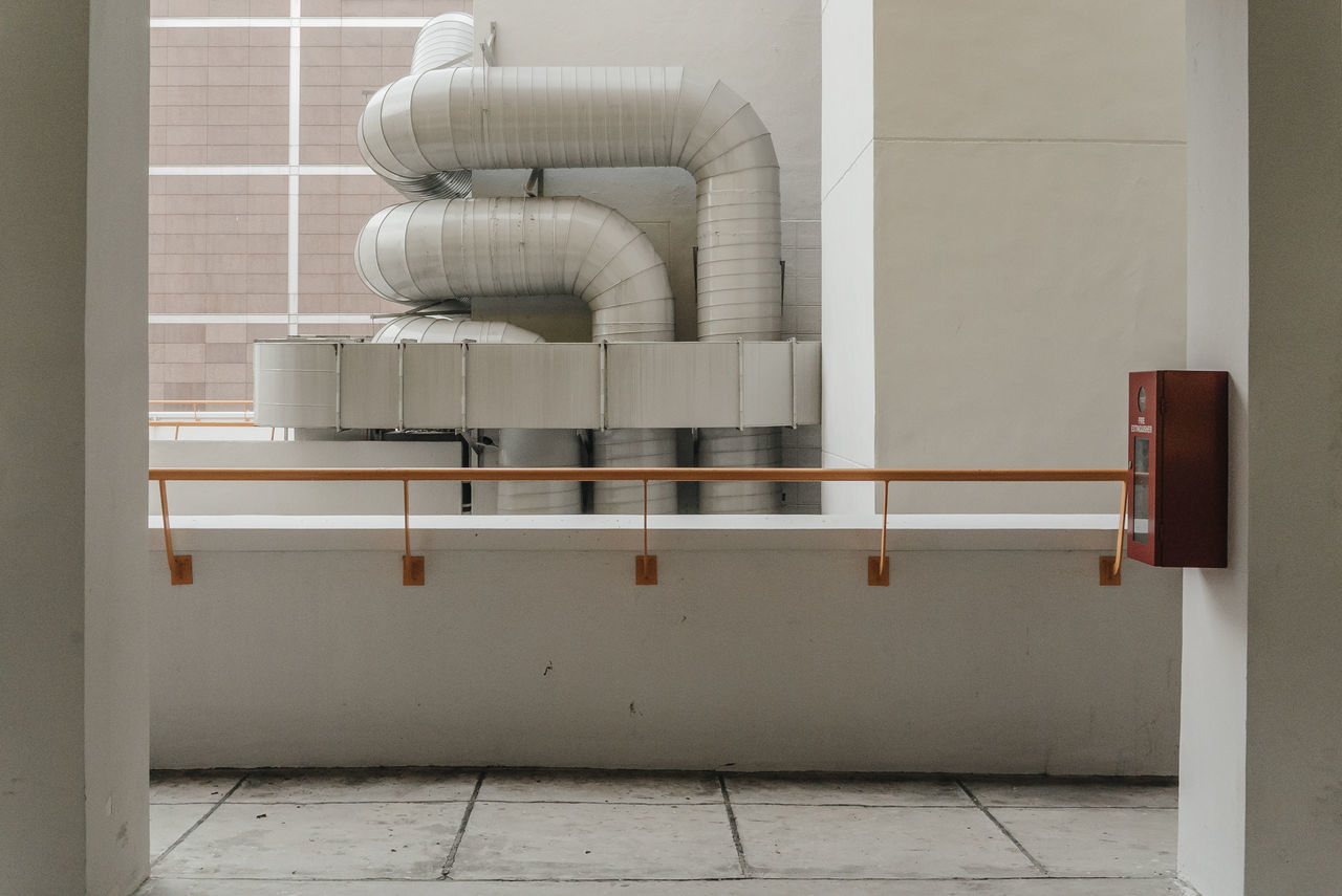 Metallic Pipes On Wall Seen From Balcony