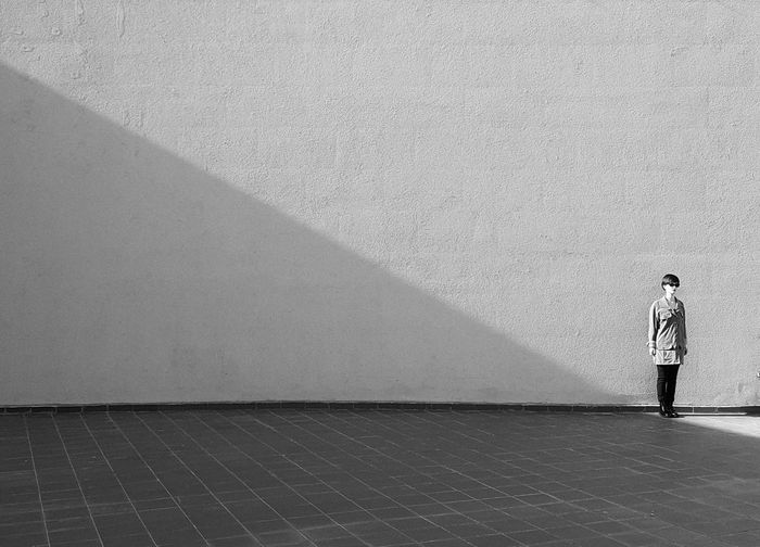 VSCO Withgalaxy Minimalism Bnwminimalismmag Bnw Blackandwhite Photography Full Length Standing Men Shadow Hiker Retaining Wall Shore Countryside Camera Calm Horizon Over Water Ocean Sandy Beach Pebble Beach Pigeon Beach Headland Mid Distance Coastline Escapism Seagull Rushing Cloud International Women's Day 2019 The Minimalist - 2019 EyeEm Awards
