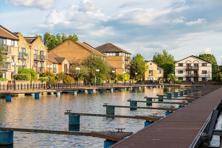 Buildings by swimming pool against sky