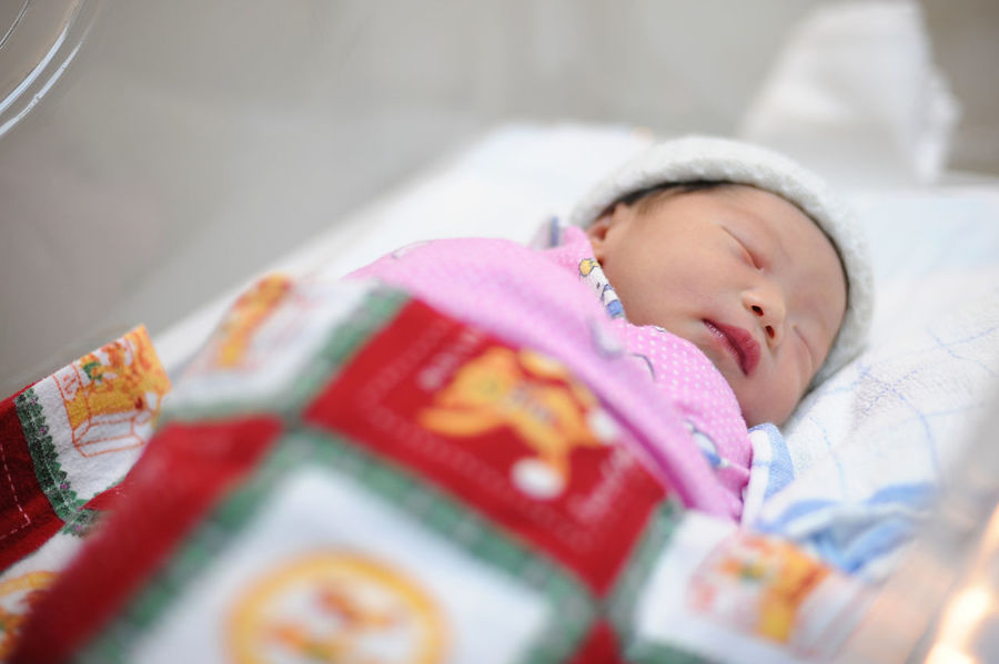 New born infant asleep in the blanket in delivery room Asian  Hospital Baby Baby Clothing Babyhood Bed Beginnings Child Childhood Clothing Cute Delivery Room Eyes Closed  Indoors  Innocence Lying Down Newborn One Person Relaxation Selective Focus Sleeping Young