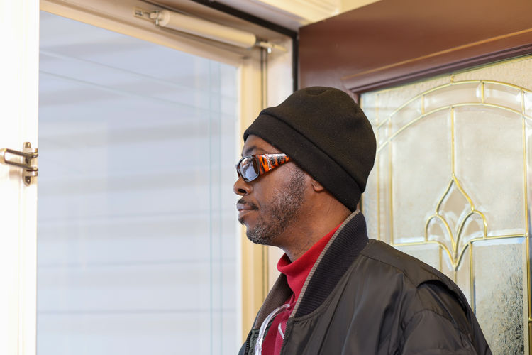 Portrait of man wearing hat standing outdoors