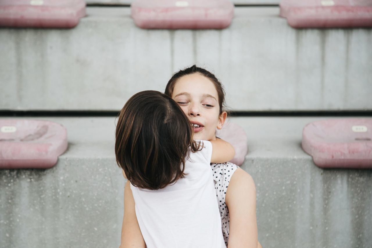 Portrait of two girls hugging