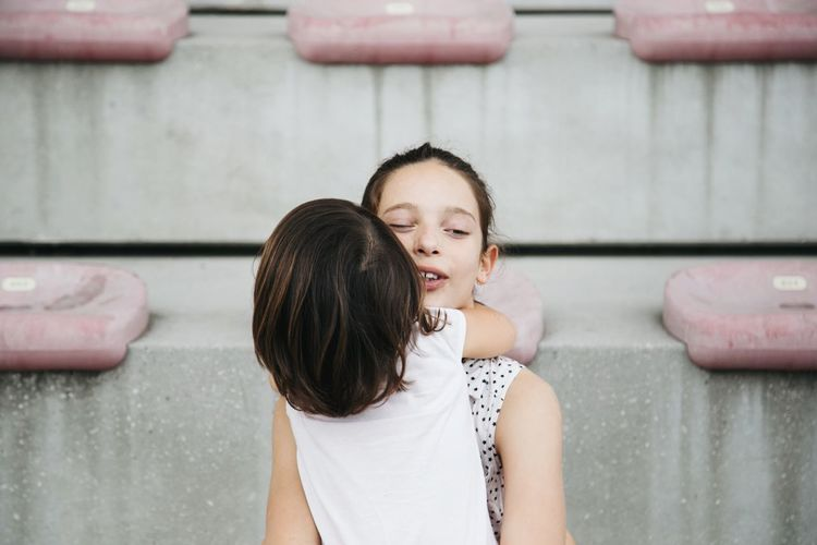 Portrait of two girls hugging