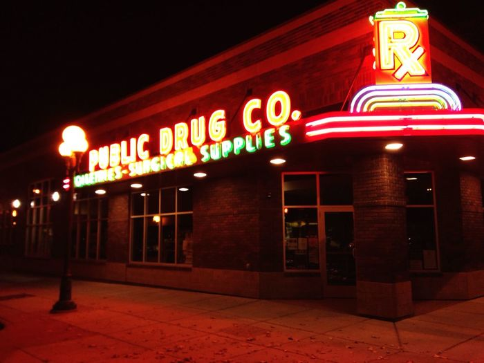 An old building burned down so they decided to build a new Public Drug store , just showing off our cool neon lights . Montana