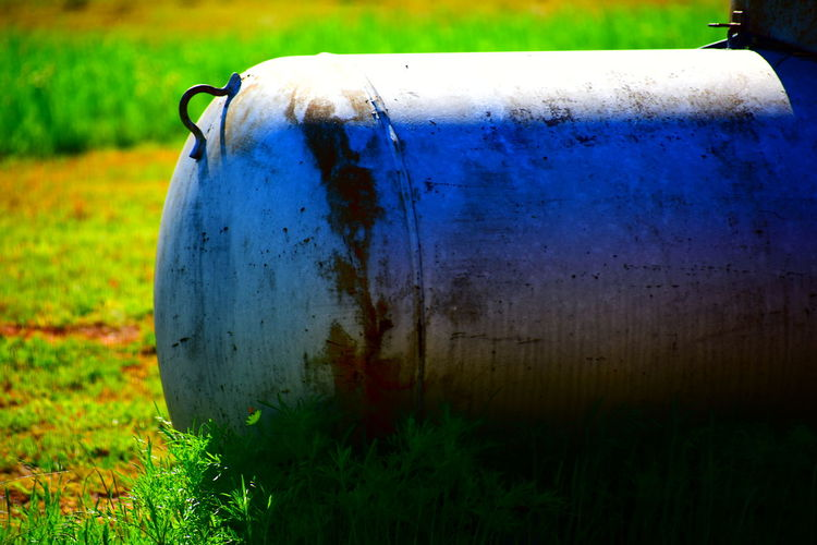 Country Life Propane Tank Water Close-up Grass