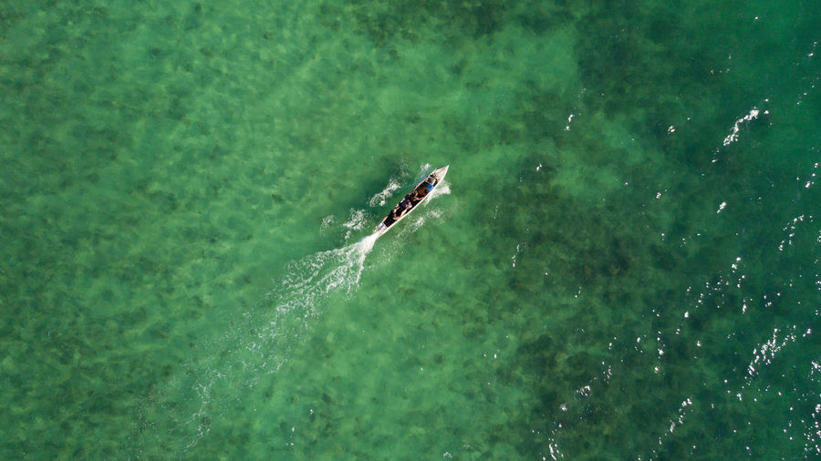 People on water pump boat on the way to their village Adventure Day Drone Photography Dronephotography Fisherman Green Color High Angle View Nature Nautical Vessel Outdoors Transportation Water Waterpump Boat