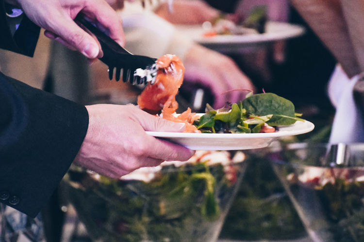 Getting food Getting Food Buffet Finger Focus On Foreground Food Food And Drink Freshness Hand Healthy Eating Holding Human Body Part Human Hand Lifestyles Midsection One Person Plate Plates Preparing Food Ready-to-eat Real People Salad Salmon Unrecognizable Person Vegetable Wellbeing