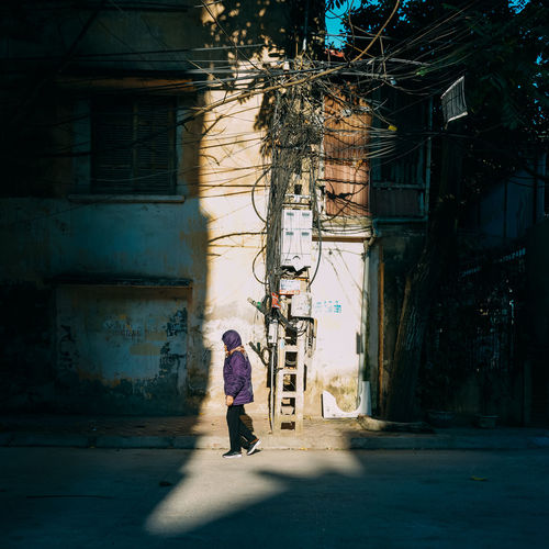 Sunlight Architecture Building Exterior Built Structure City Full Length One Person Real People Walking Lifestyles Women Shadow Day Building Street Rear View Adult Sunlight City Life Outdoors Sunlight StillLifePhotography Streetphotography Hà Nội, Việt Nam
