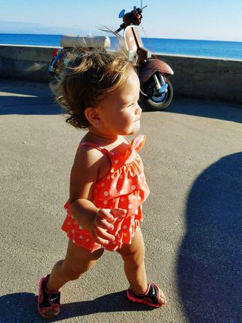 Little diva practicing her catwalk Squinting Walking Nike Swimsuit Toddler  Outdoors Girl Sunlight Childhood Real People Leisure Activity Full Length Shadow Beach Day One Person Outdoors Lifestyles Sea Sky People Toddler  Child Baby Young Innocence Offspring
