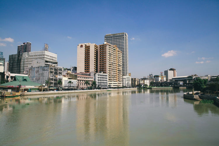 Cityscape By Pasig River Against Sky