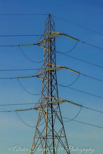 Technology Electricity Pylon Golf Club Girder Steel Electricity  Fuel And Power Generation Cable Clear Sky Global Communications Electricity Tower High Voltage Sign Tall Countryside Electrical Grid Power Cable