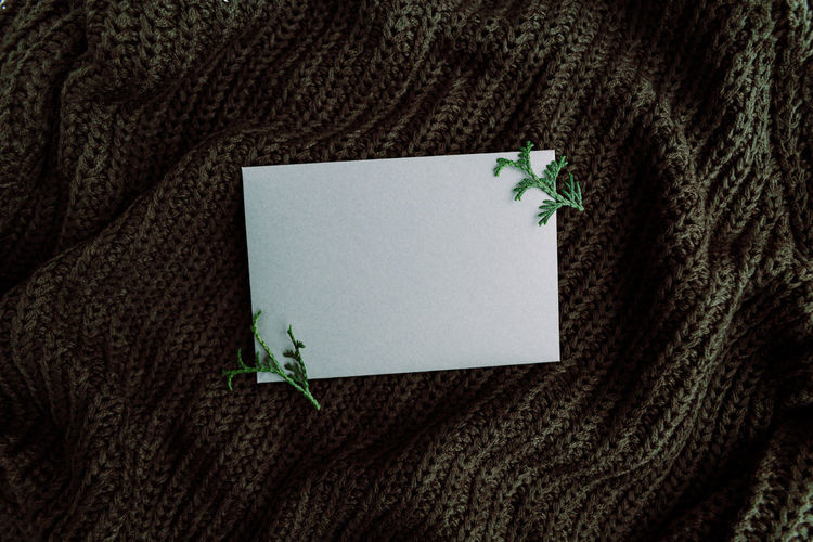 Directly above shot of envelope on sweater