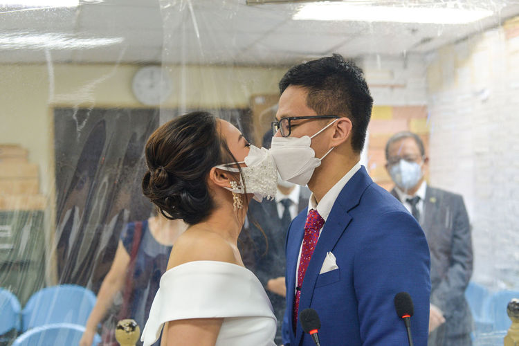 Young married couple wearing masks during covid19 pandemic