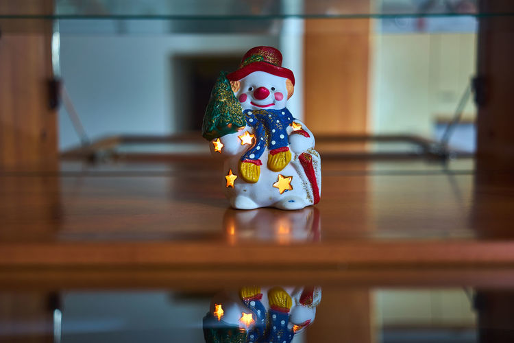 Close-Up Of Snowman Figurine On Table At Home