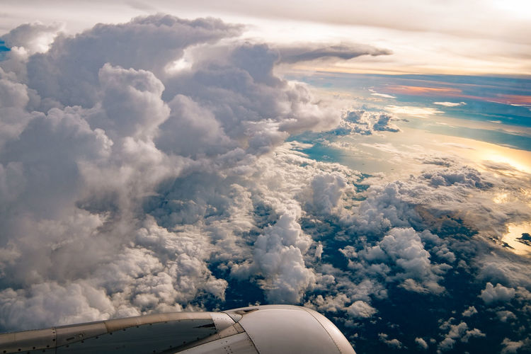 Clouds formation Aerial View Air Vehicle Airplane Airplane Wing Beauty In Nature Cloud Cloud - Sky Cloudscape Commercial Airplane Day Flying Jet Engine Journey Mid-air Mode Of Transport Nature No People Outdoors Scenics Sky Sky Only Transportation Travel