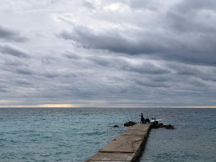 Palma de Mallorca, Spain Bad Weather Weather Cloud - Sky Day Evening Fisherman Fishing Grey Clouds Horizon Over Water Leisure Activity Non-urban Scene Outdoors Pier Sea Stormy Sky Tranquil Scene Water