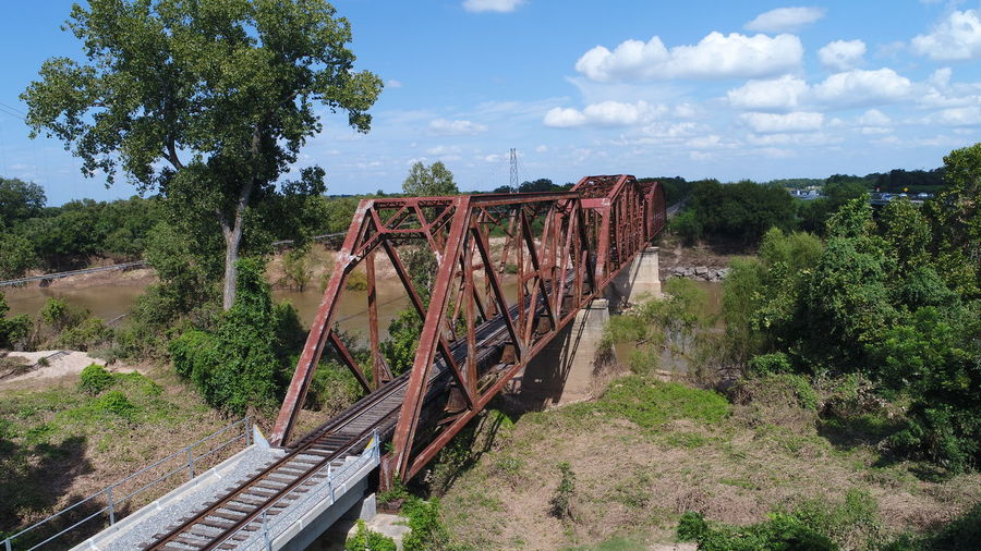 Train Tracks Architecture Beauty In Nature Bridge - Man Made Structure Built Structure Cloud - Sky Day Landscape Mountain Nature No People Outdoors Plant Rail Transportation Scenics Sky Train Train Bridge Transportation Tree