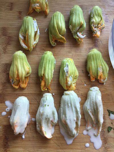 Ricotta stuffed squash blossoms ready to be battered and fried. Cooking Zucchini Brussels Sprout Close-up Cutting Board Day Food Food And Drink Freshness Healthy Eating High Angle View Indoors  No People Squash Squash Blossoms Still Life Table Vegetable Wood - Material Zucchini Flower