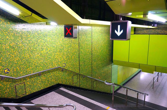 Hong Kong, re-up 2013 Architecture Arrow Symbol Built Structure Ceiling Flooring Green Color Illuminated Indoors  Lighting Equipment No People Number Railing Sign Staircase Steps And Staircases Tile Wall - Building Feature Yellow