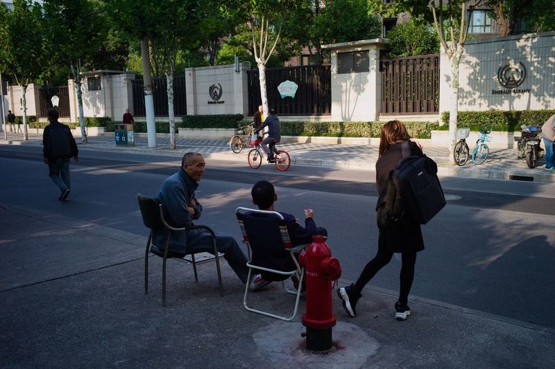 People sitting on street in city