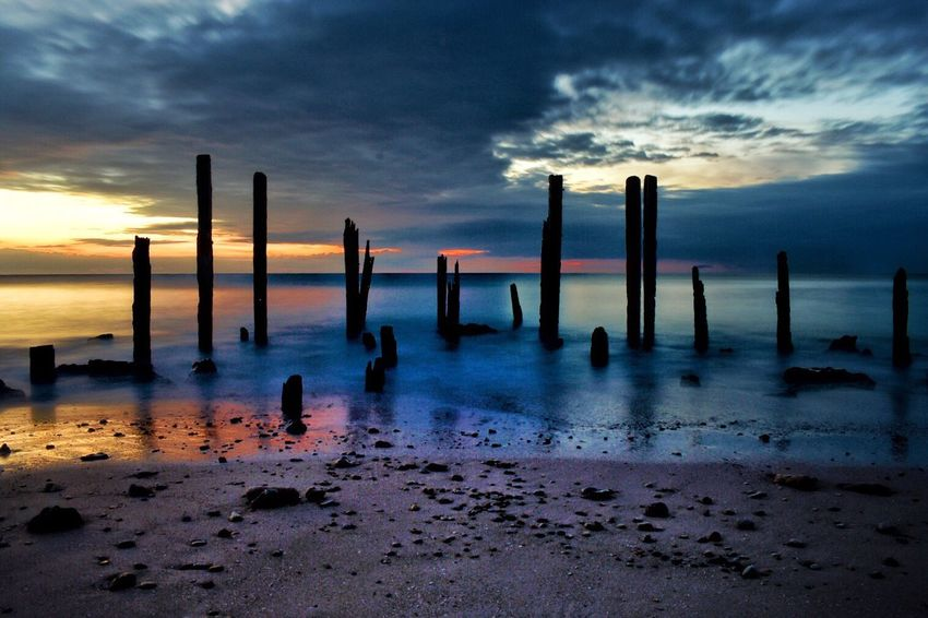 Sunset Sky Sea Cloud - Sky Water Beach Horizon Over Water Nature Scenics Beauty In Nature Shore Tranquility Tranquil Scene Wooden Post Sand Outdoors No People Day