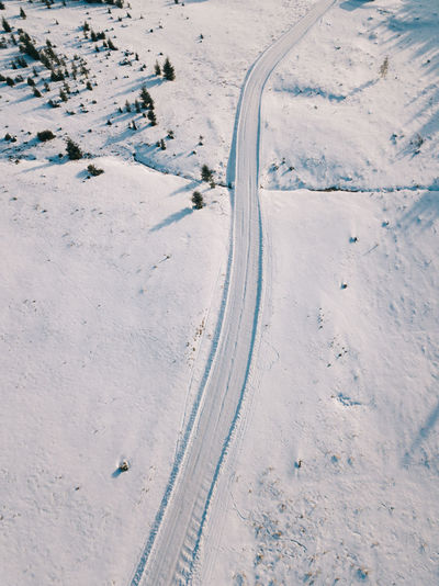Aerial View Beauty In Nature Cold Temperature Covering Day Environment Field High Angle View Land Nature No People Road Scenics - Nature Ski Track Snow Snowcapped Mountain Tranquility Transportation White Color Winter