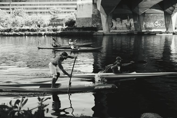 Men Rowing Boats In River