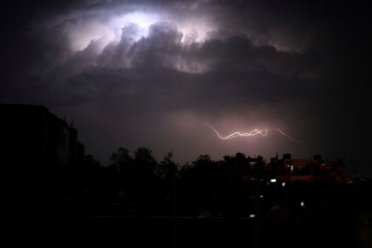 Scenic view of lightning in sky at night