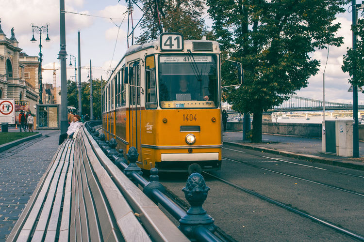 Tram in Budapest on riverside of Danube Budapest Built Structure City Danube Day Euroespresso Europe Explore Exploring Holiday Mode Of Transport Movement Outdoors Public Transportation Rail Railroad Track Relaxing River Side View Sky Train Tram Transportation Travel Way