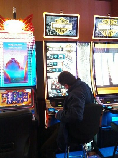 One Person Adult Indoors  Gambling Taking Photos Sitting casino