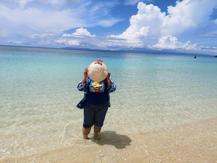 Haterumajima EyeEm Selects Water Full Length Sea Beach Sand Adventure Sun Hat Standing Rear View Beach Holiday