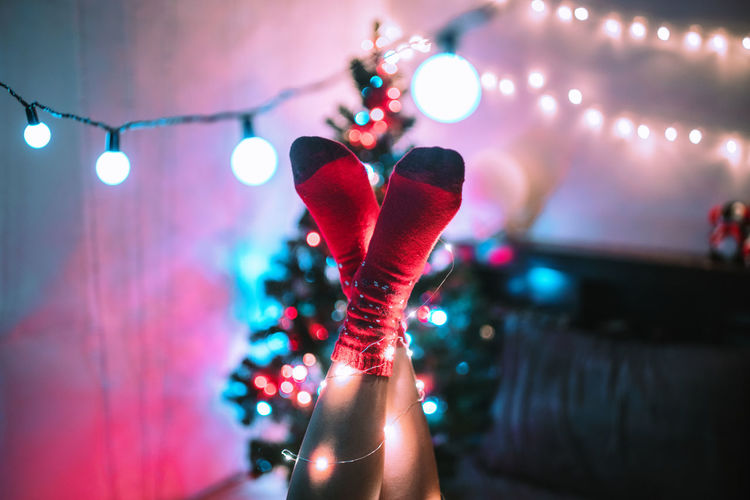 All you need is tea and warm socks. Christmas ❄🎅🎄Fairy lights wrap on the feet wear red Christmas socks with christmas lights background, Night Real People Light Vintage Music Nightlife Women Light And Shadow Stage Celebration Christmas Christmas Lights Illuminated Christmas Decoration Socks Nightclub Lifestyles Human Hand Lighting Equipment Focus On Foreground Arts Culture And Entertainment Human Limb Arms Raised Christmas Ornament Capture Tomorrow