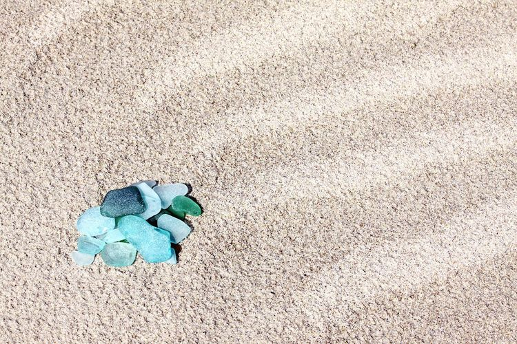 High Angle View Of Stones On Sand At Beach