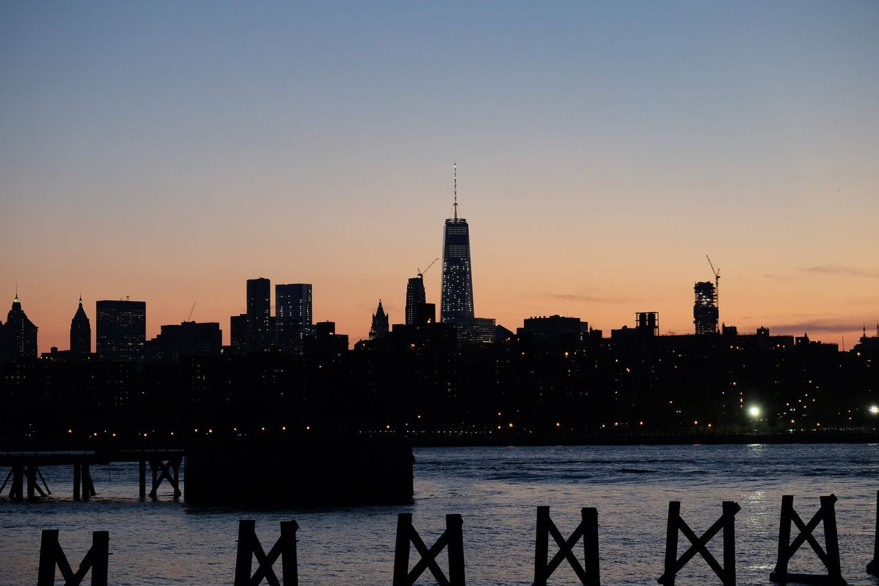 One World Trade Center In City Against Sky During Sunset