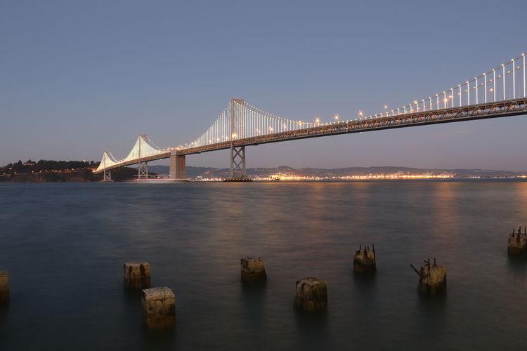 Illuminated long suspension bridge at night