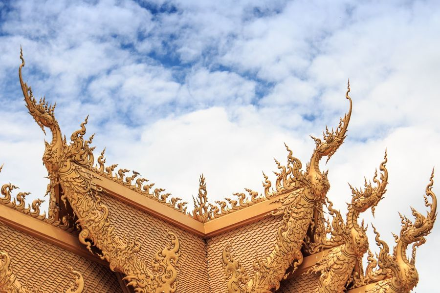 Thailand WatRongKhunWhiteTemple Architecture Art And Craft Building Building Exterior Built Structure Carving Cloud - Sky Craft Creativity Day Design High Section Low Angle View Nature No People Ornate Outdoors Pattern Roof Sculpture Sky Tree
