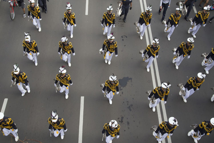 High angle view of marching band on street