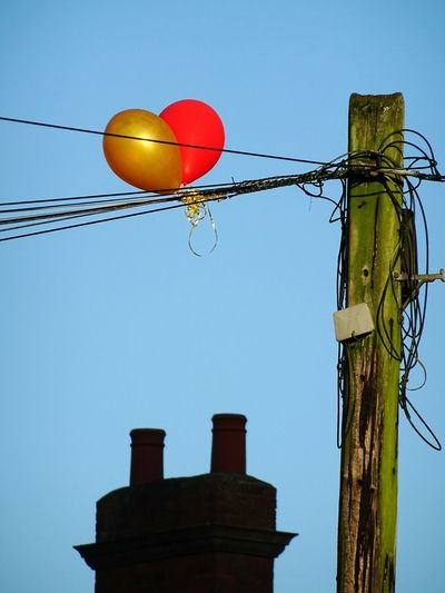 Blue Clear Sky No People Low Angle View Sky Outdoors Day Balloons Ballon Telegraph Pole Telephone Line Red And Yellow Bridgnorth EyeEm Best Shots EyeEmBestPics EyeEm Gallery Shropshire