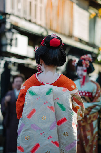 Rear View Of Woman Wearing Kimono At Road