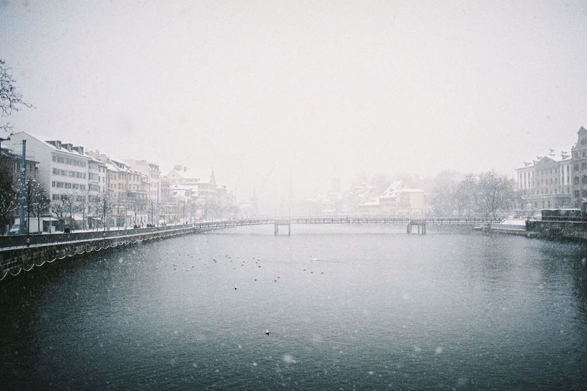 white Zurich. Film Photography Filmisnotdead Minolta EyeEmNewHere Analogue Photography Architecture Built Structure Building Exterior City Water Cityscape Switzerland Zürich Cold Temperature Copy Space River Waterfront Day Skyscraper No People Sky Fog Nature Snow Urban Skyline