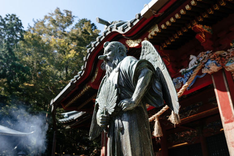 Statue in front of a shinto shrine near the summit of Mt. Takao near Tokyo. Shinto Shrine 飯縄権現社 東京 Shrine Place Of Worship Creativity Day Spirituality Belief Religion Statue Low Angle View Sculpture Art And Craft 高尾山 EyeEm Best Shots EyeEm Nature Lover EyeEm Selects