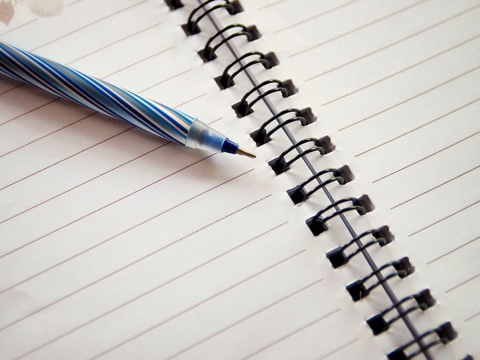 High angle view of pen on paper