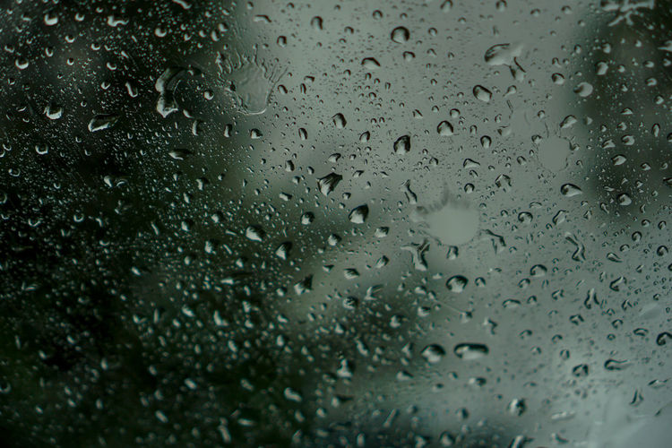 blur backgruond,Rain water on the car glass Drop Wet Rain Water Glass - Material Window Transparent Indoors  Backgrounds RainDrop Full Frame No People Close-up Rainy Season Nature Selective Focus Monsoon Glass