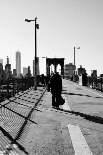 Too long walk Burden Of The Past From Brooklyn To Manhattan The Brooklyn Bridge Old Man Walking Travel Photography New York City Following The Path... Right Ahead Man City Cityscape Urban Skyline Sky Architecture Shadow EyeEmNewHere