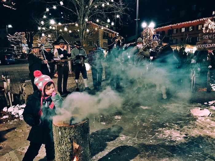 Just Gonna Stand There And Watch Me Burn Night Italy Real People Winter Outdoors Celebration Illuminated People Moena Christmastime Burn Fire Music Musicians IPhoneography Streetphotography Candid IPhone 7