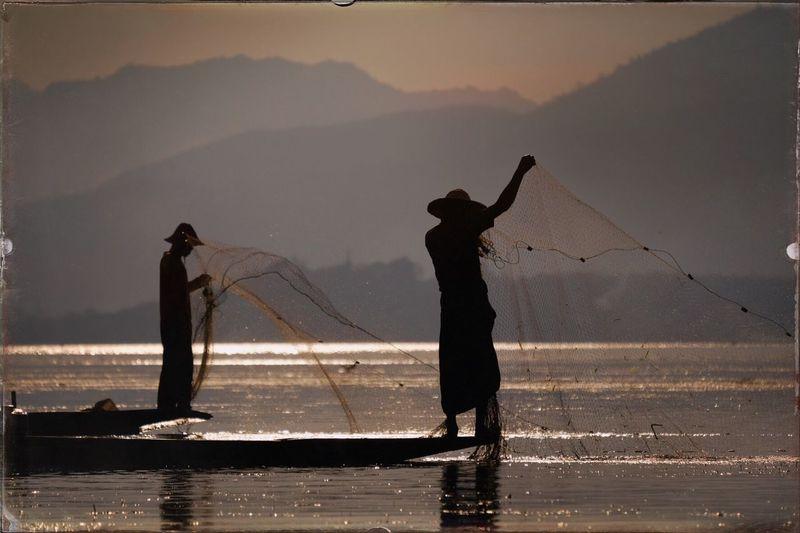 Fisherman in the evening sun, Lake Inle, Myanmar Fisherman Travel