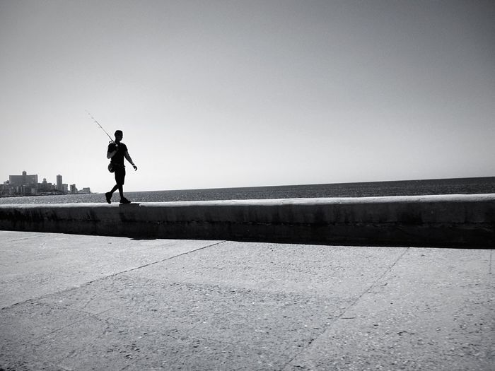 Cuba Havana Havanna, Cuba Travel Fisherman Fishing Walking Silhouette Black And White Black & White Black And White Photography Telling Stories Differently The Essence Of Summer Fine Art Photography Monochrome Photography TakeoverContrast The Street Photographer - 2017 EyeEm Awards The Week On EyeEm An Eye For Travel